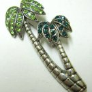 Fashion pin brooch palm trees silver with green crystals
