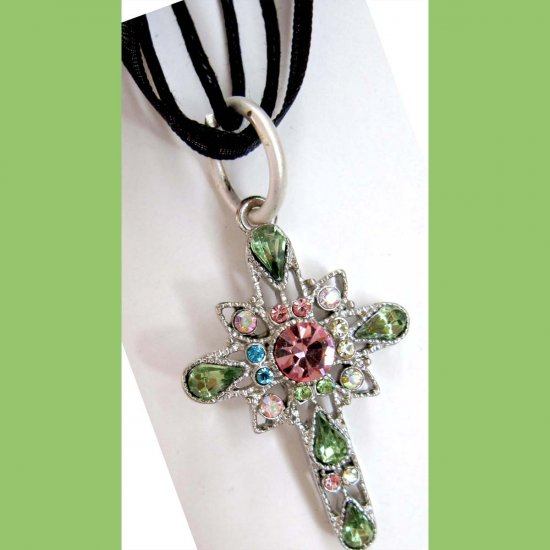 Cross pendant green and pink crystals on black cord