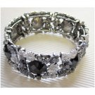 Flower bracelet in black silver and gray hinged - new