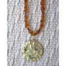 Amber with glass accents and detachable gold leaf pendant