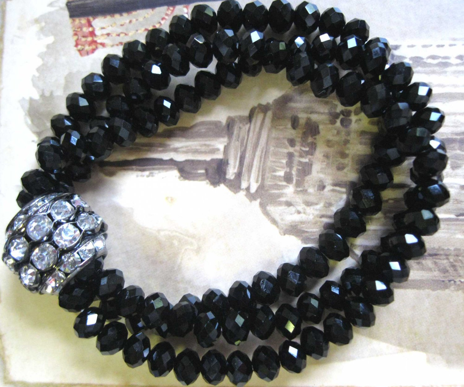 Triple row faceted crystals with black accent slip on bracelet