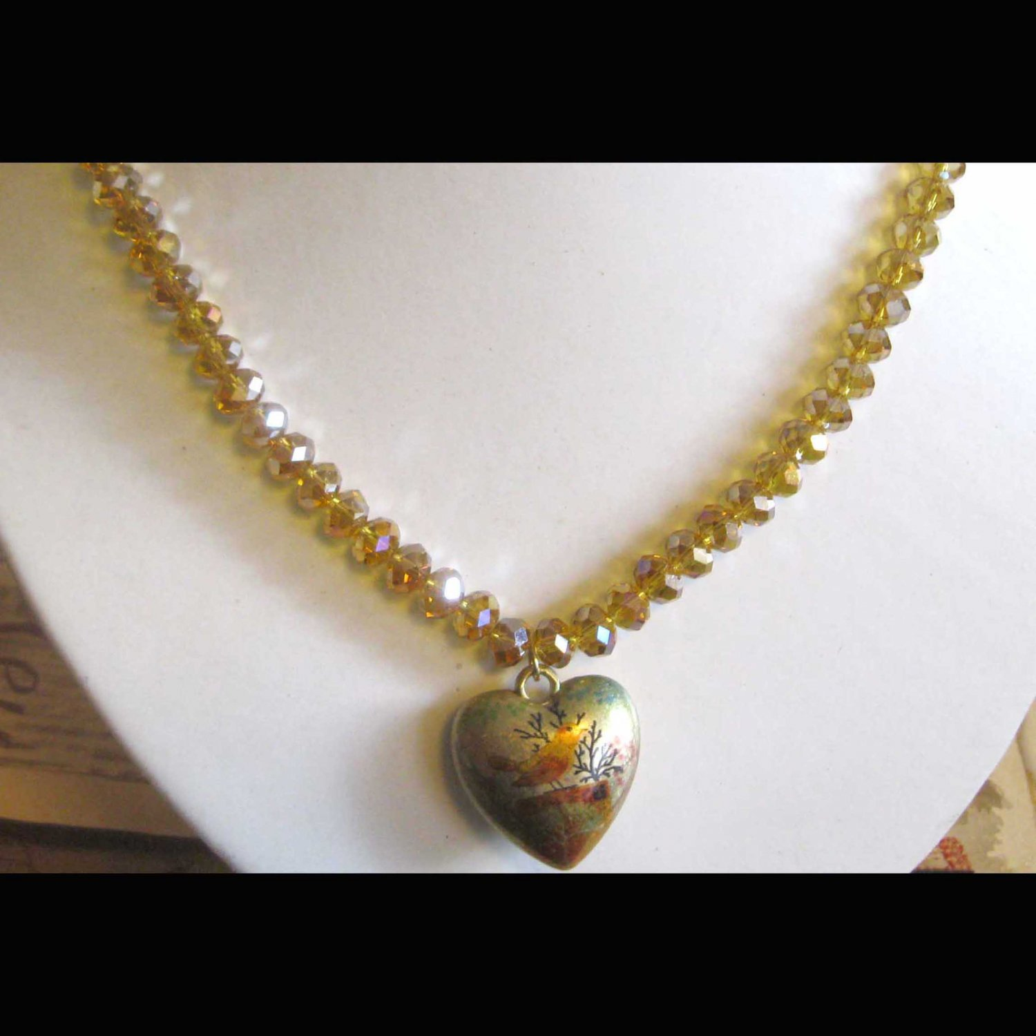 Gold fashion necklace with heart bird pendant