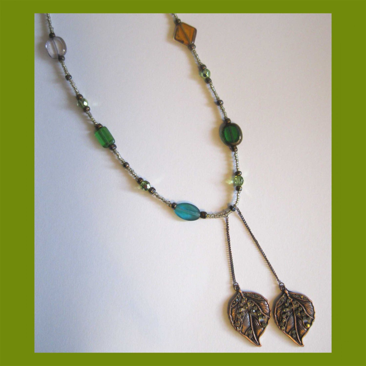 Browns and greens one of a kind fashion necklace with double leaf pendants