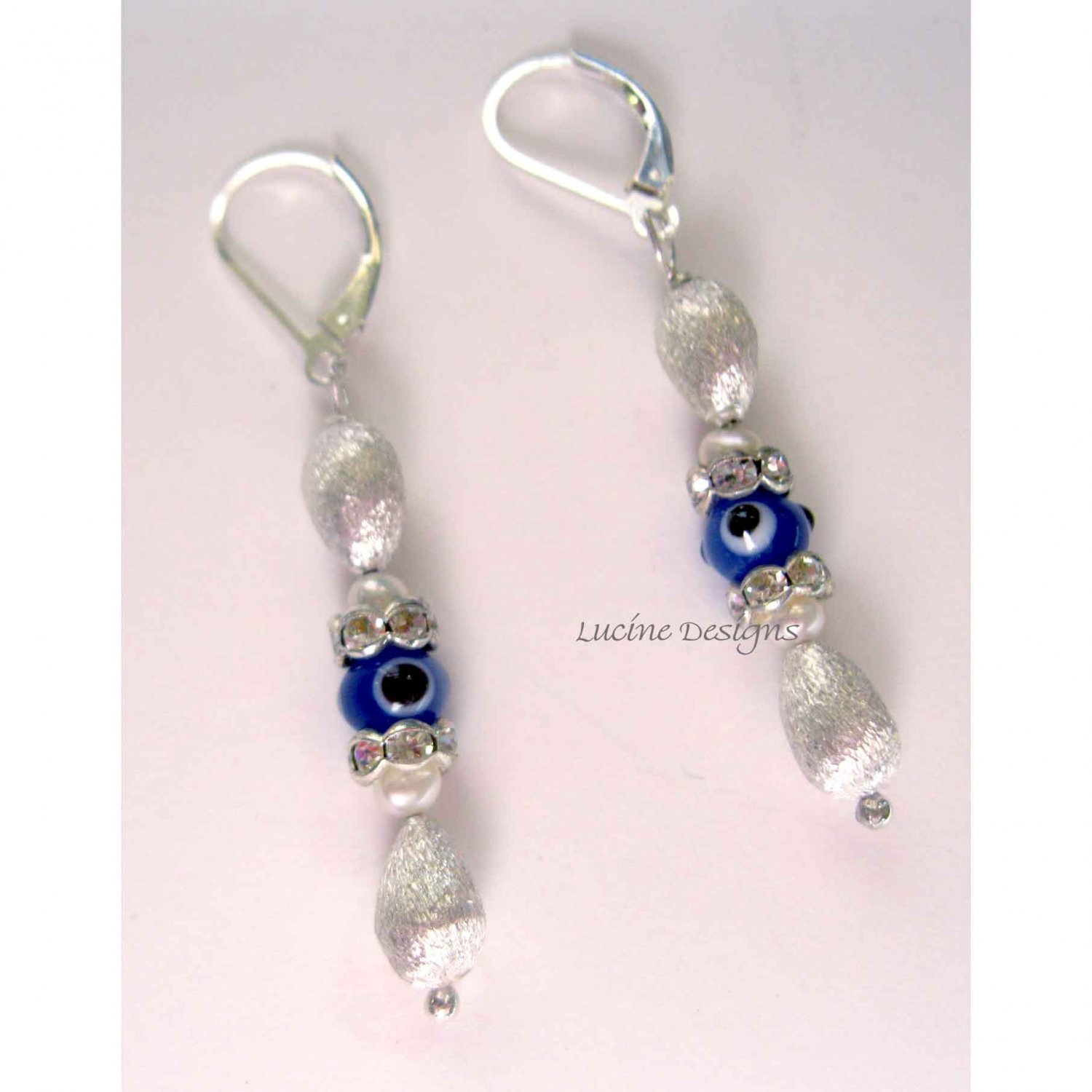 Blue evil eye sterling silver with pearls and crystals earrings
