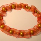 Orange slip on ribbon f.w. cultured pearl fashion bracelet
