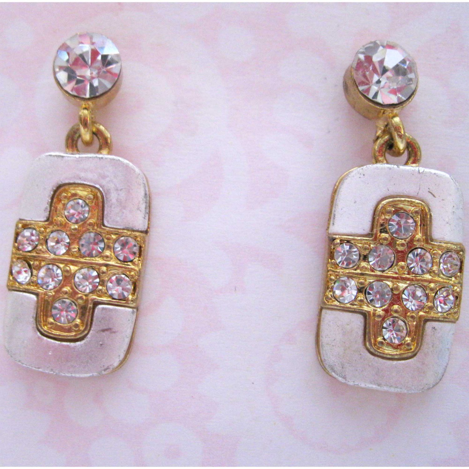 Silver and gold cross earrings with white crystals