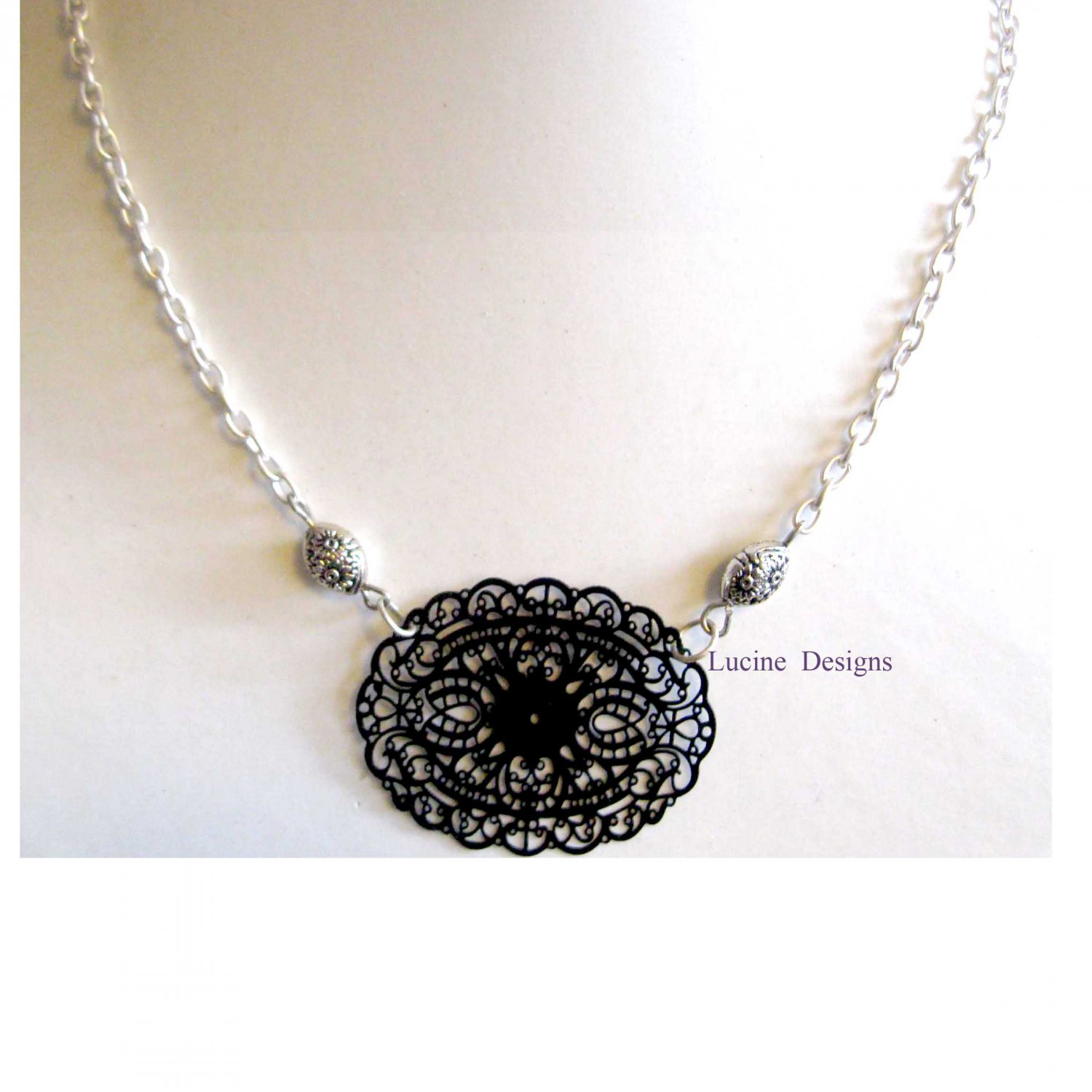 Silver necklace with lasercut black