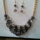 Statement gold and grey beaded necklace and earrings set