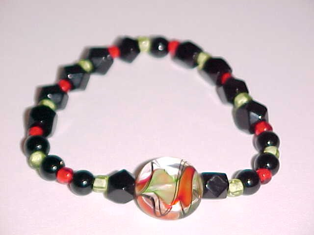 (SOLD) Red, Black, Green Swirl Beaded Stretch Bracelet 7 inches