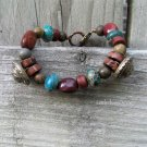 Moukaite nuggets and LaMode stem buttons with turquoise Jasper rondelles bracelet