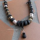 Necklace:  Antique brass plated lion and elephant, poly clay beads