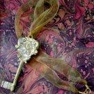On Key: Vintage-inspired Golden Filigree Key Pendant Ribbon Necklace