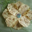 Light yellow and beige fabric flower