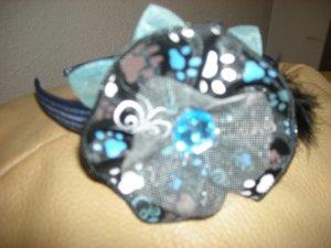 Hard plastic fabric rosette flower headband