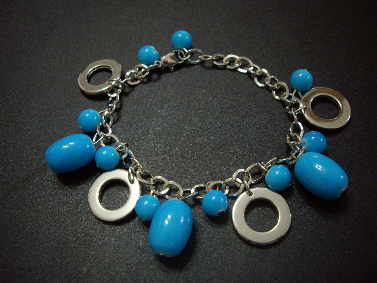 Fashionable blue beads with silver hoops bracelet