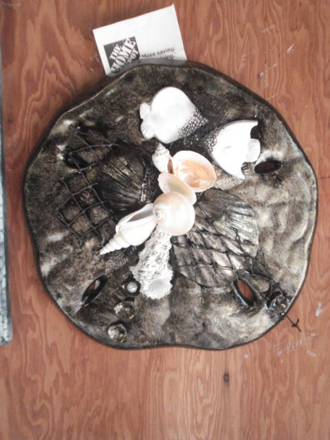 Sand Dollar Plaque Black/Gold with fish Accents