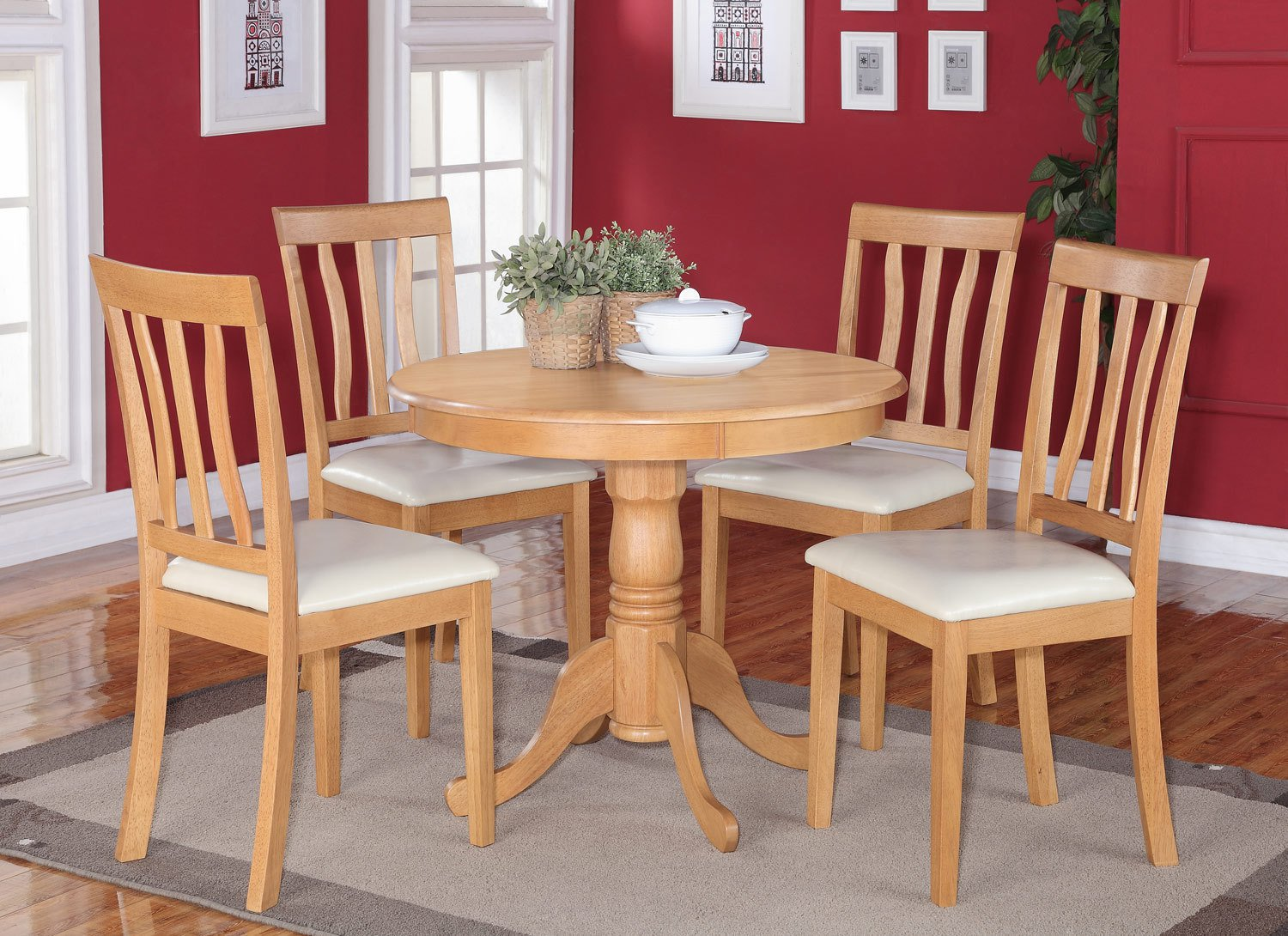5pc round dinette table set and 2 faux leather upholstered