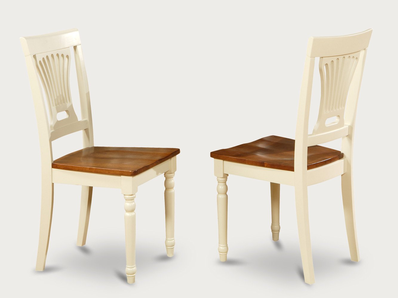 Set of 2 Plainville dining room chairs with wood or cushion seat in buttermilk finish.