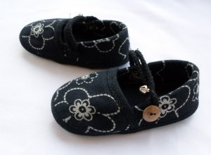 Funky colourful childrens shoes for boys or girls. Black and white. Baby toddler small size.