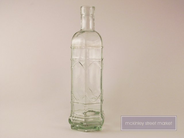 VINTAGE CLEAR 6 SIDED DECORATIVE GLASS BOTTLE 10 IN
