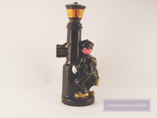 NEVER ON SUNDAY HOBO LAMP POST BOTTLE