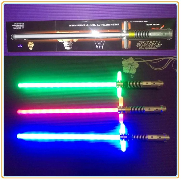 Buy Telescopic Cosplay cross shaped Star Wars Lightsaber Weapons Sword with Light saber Action Figu