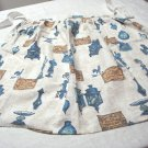 Oil lamps, compote dishes, weather vanes on cotton half apron vintage hc3285