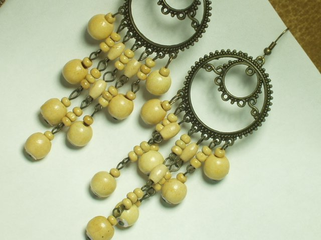 Copper tone earring with dangle ivory bead