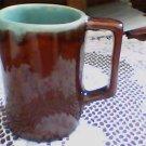 brown glaze cup,mug w/handle htf green inside very neat