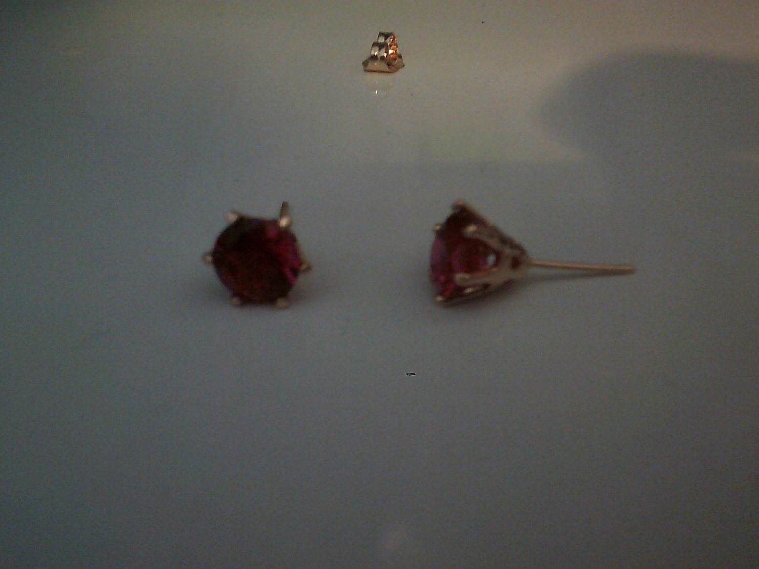 18k gold plated earrings with ruby colored cz stone