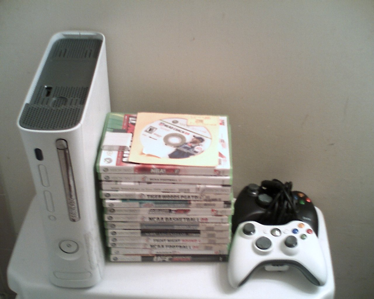 xbox 360 with 14 top selling games and 2 contollers