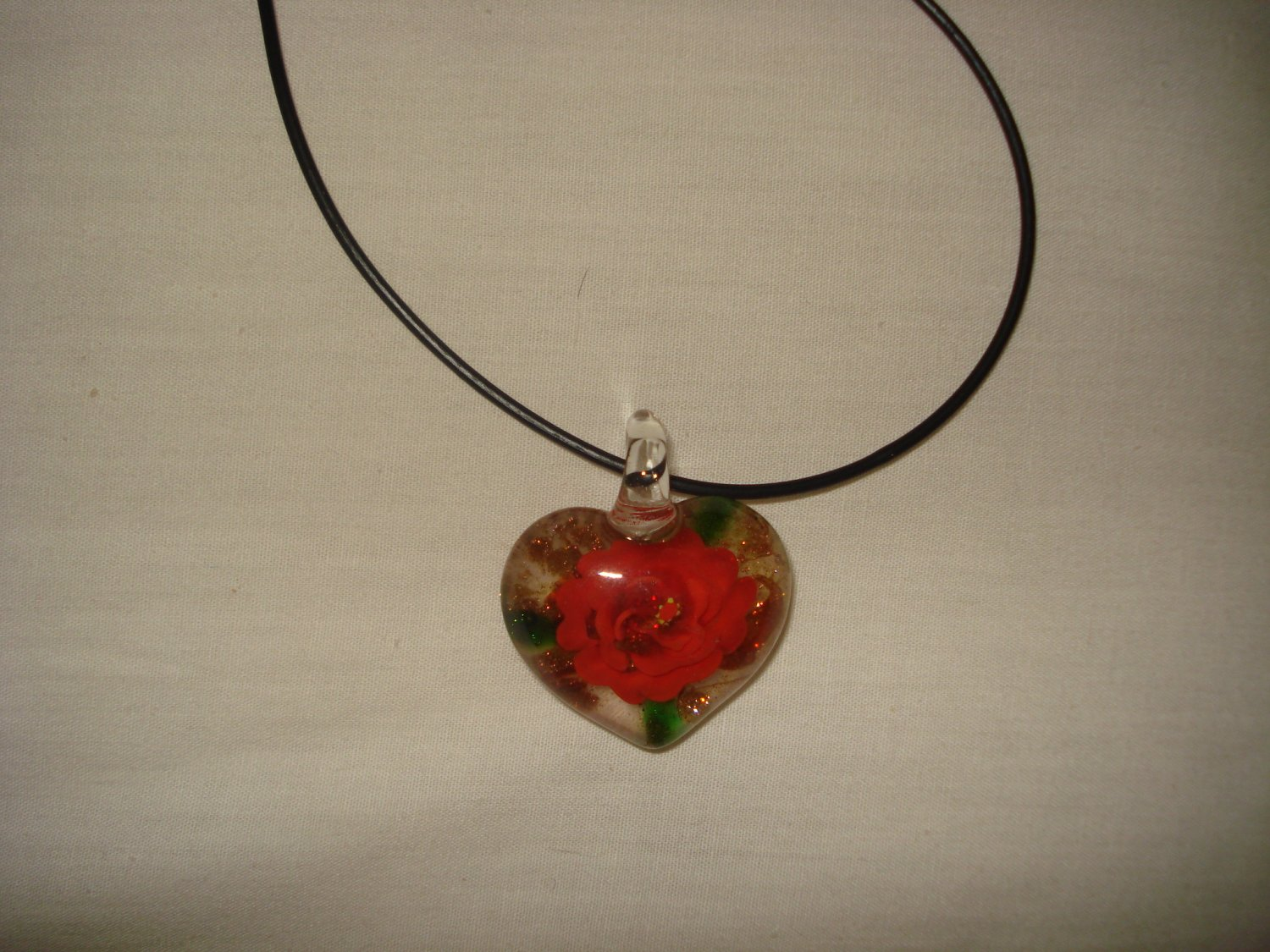Red rose in a clear puffy heart glass pendant - eg06