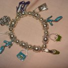 Silver stretch bracelet with enameled purse & shoe charms - eg23