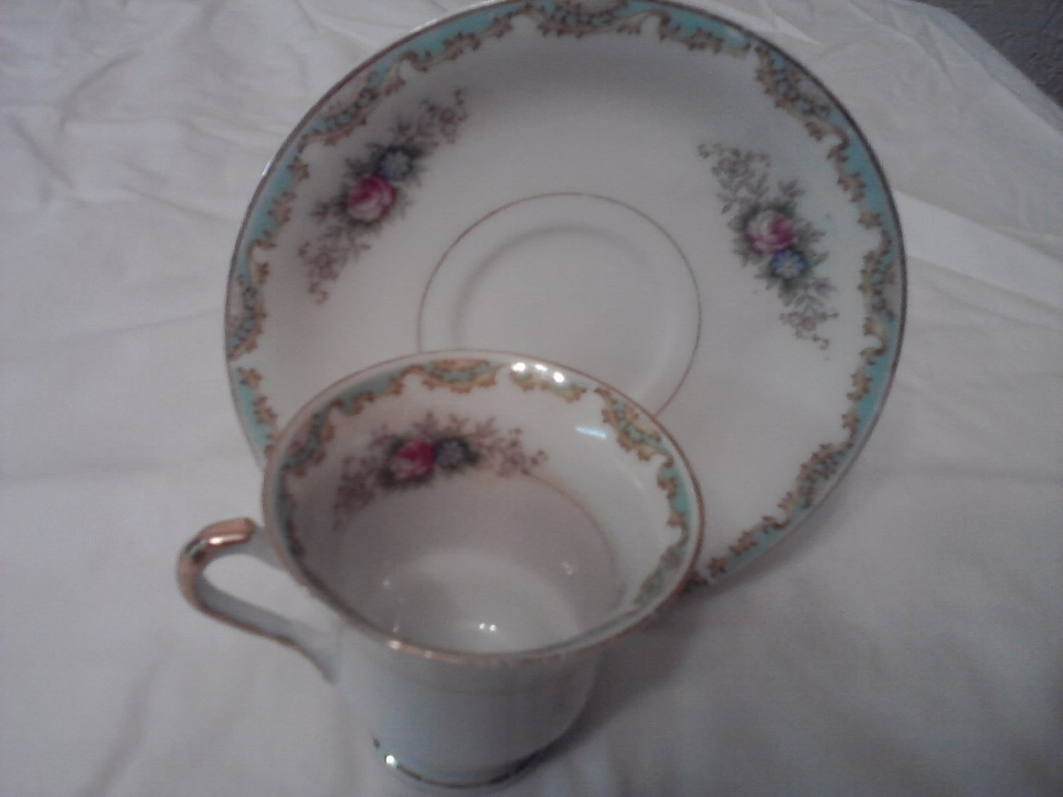 Vintage Hand painted Mini-teacup and saucer