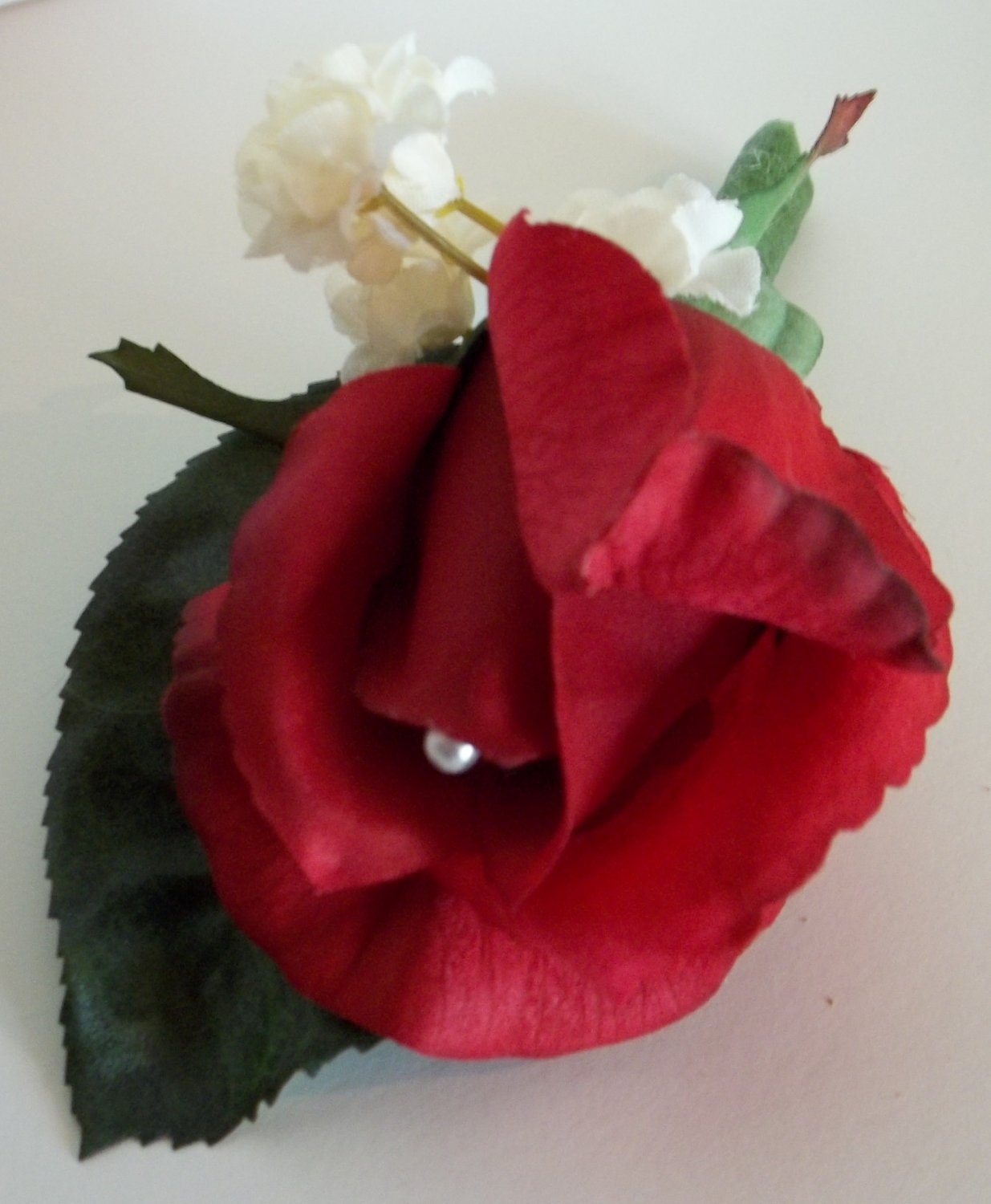 True Touch Boutonniere. Single Rose bud with pearl pin accent.From Customweddingdesigns