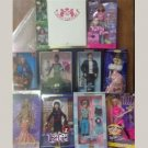 12 Vintage and New Barbies New In Box Lot