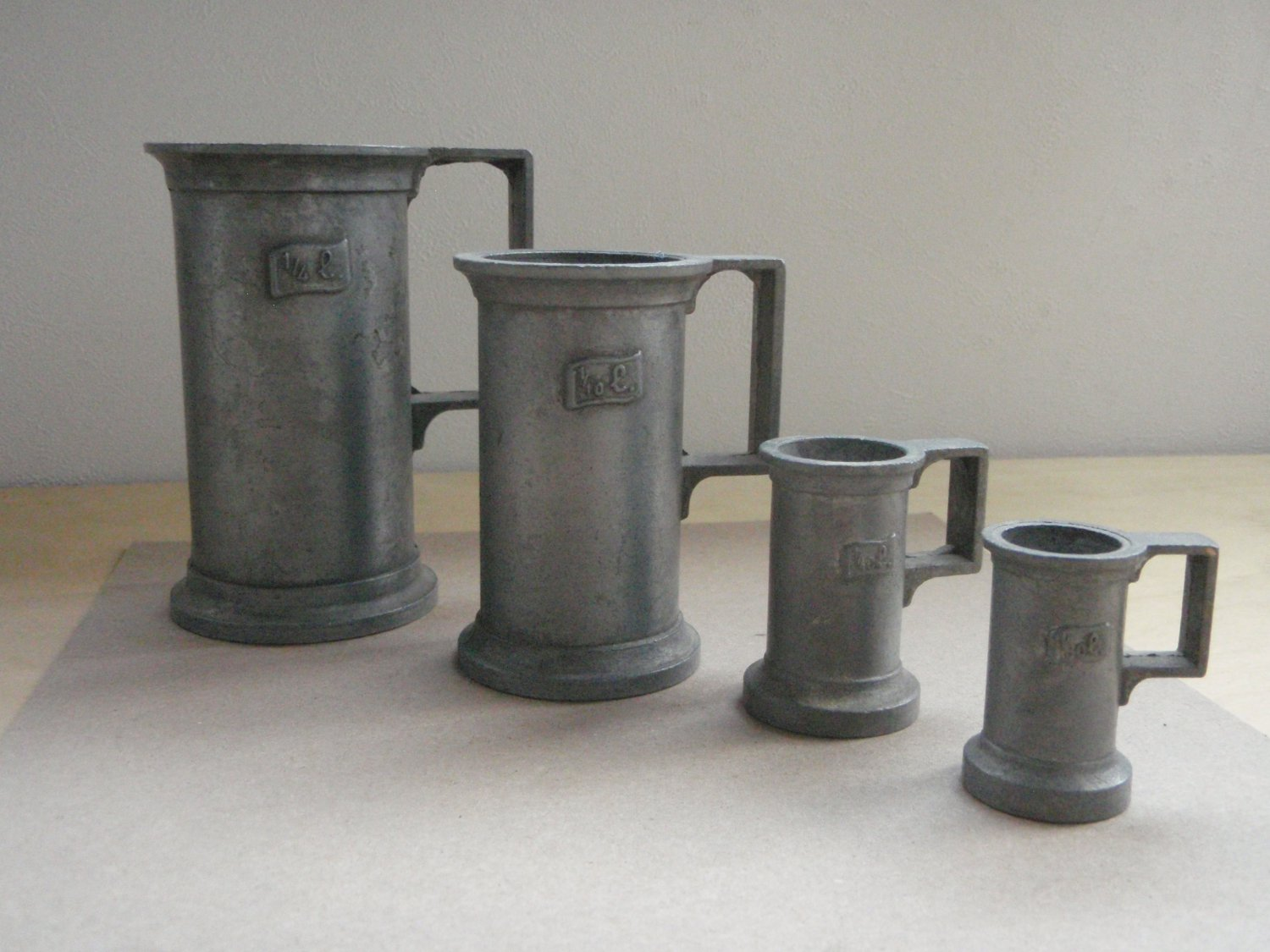 "Antique Set of Pewter Measuring Steins ""Peltrato 95%"""