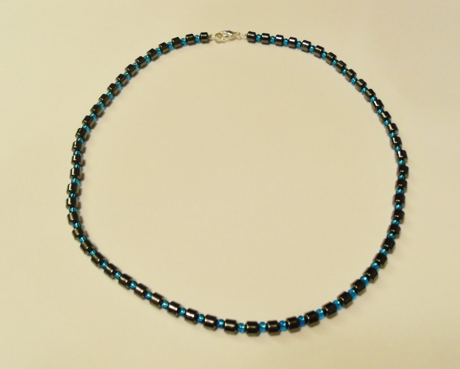 Hematite and clear blue surfer necklace