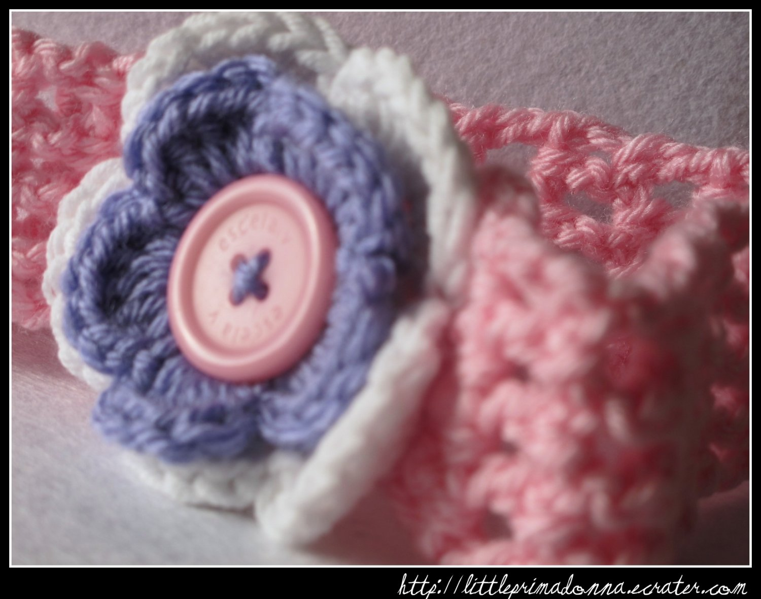 Crocheted headband with layered flower for baby