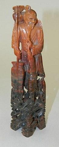 Oriental hard stone carving of man with fish