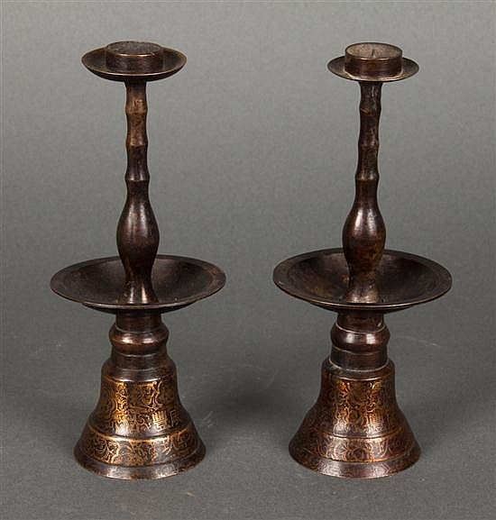 Pair of Chinese patinated metal altar candlesticks