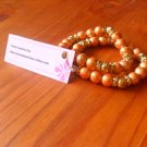 Orange / Golden foil beads
