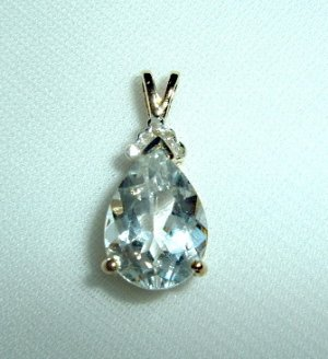 Bautiful White Topaz Pendant set with gold over silver