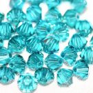 12 SWAROVSKI CRYSTAL BLUE ZIRCON- 4MM BICONE BEADS