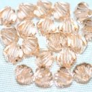 12 SWAROVSKI CRYSTAL LIGHT PEACH- 4MM BICONE BEADS