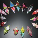 20 multi-colored origami cranes made with recycled paper
