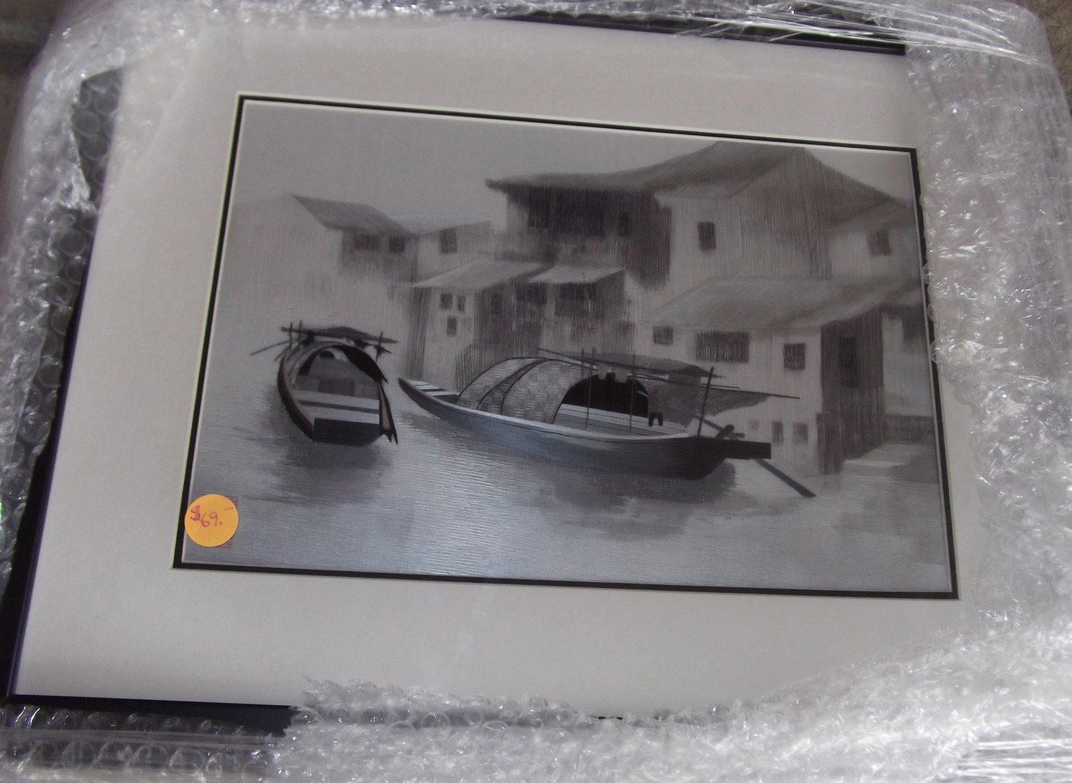 Boat on river with house in background