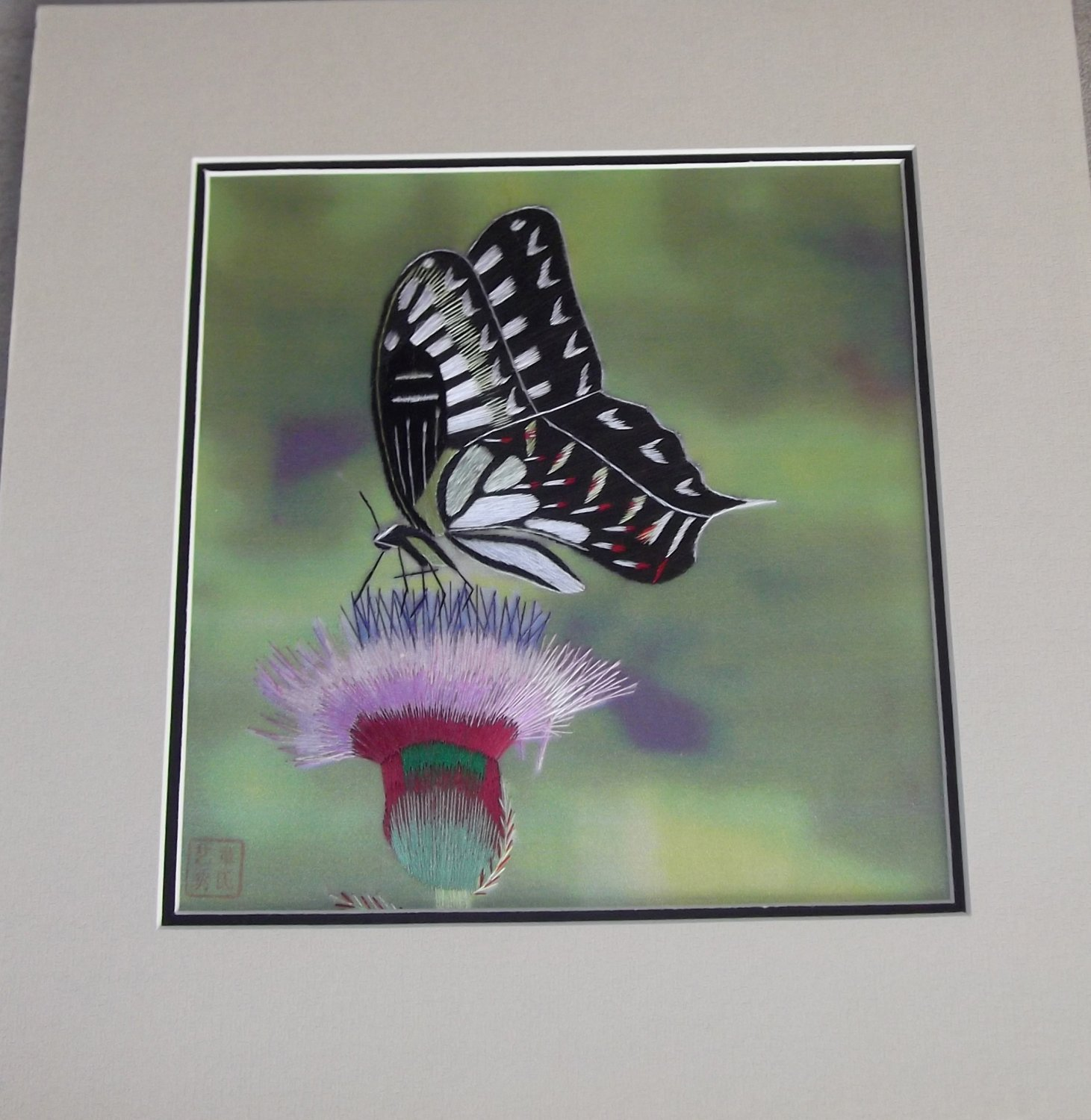 Black and white butterfly on a pink flower