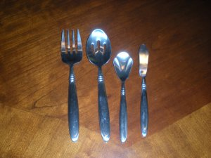 4 piece Farberware Serving Utensils