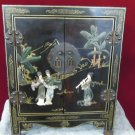 Asian Black lacquer Small Chest raised figures woman playing flute floral gold accents